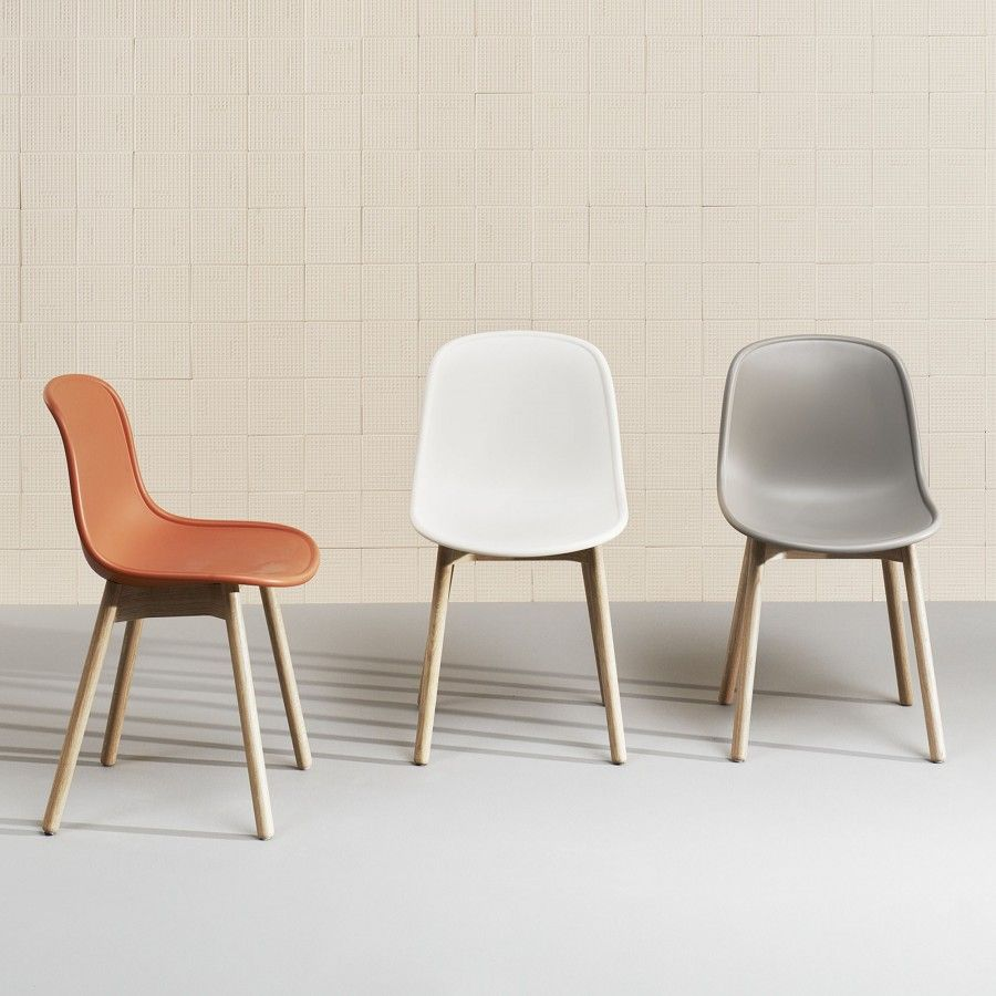 The grey NEU 13 chair with oak base by the brand Wrong for Hay has an elegant silhouette. Decoration and design furniture in Paris. Colonel shop