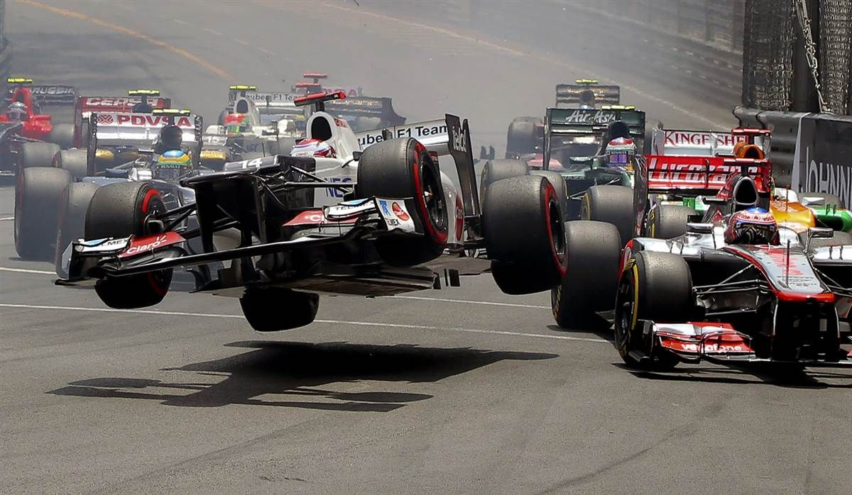 Japanese Formula One driver Kamui Kobayashi, center, jumps with his car following a collision during the start of the 2012 Monaco Formula One Grand Prix in Monte Carlo on Sunday, May 27.
