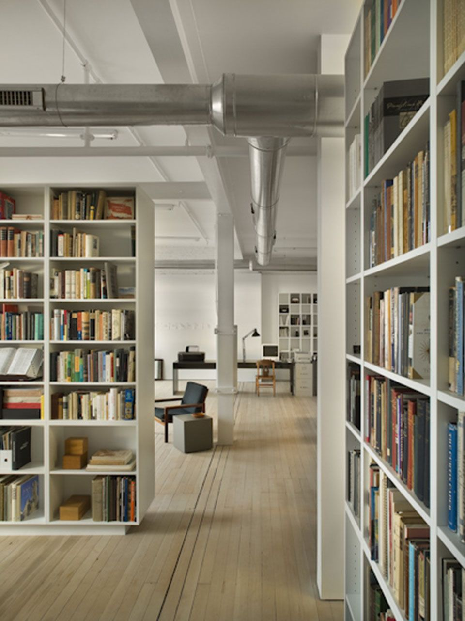 Super Minimalist Loft In Philly But So Warm And Welcoming With All Those Books White By Philadelphia Smart Storage Bookshelves Display