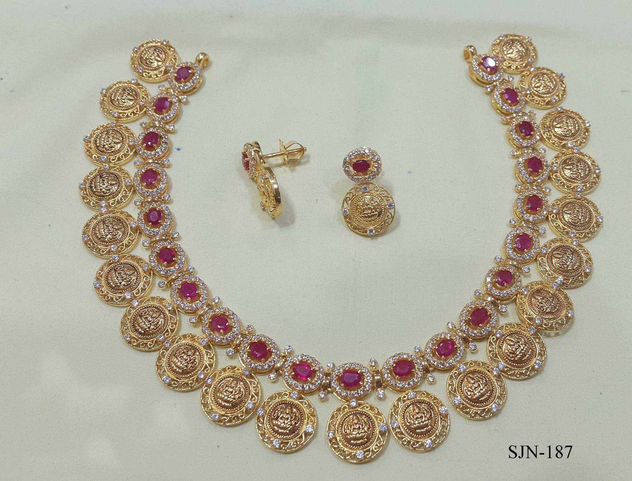 Lakshmi kasu mala necklace set in gms with red stones adorned