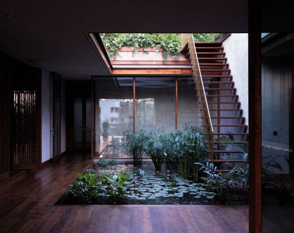 We love how this beautiful courtyard pond garden was incorporated into the house on pali hill in india designed by studio mumbai architects
