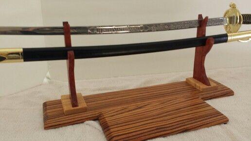 Sword display,  zebrawood , maple and bubinga. Check out www.buildburnsatisfy.com