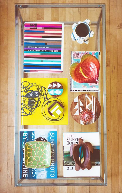 We know, we know, you're already styling with (and we would hope: reading!) coffee table books. But instead of stacking them, consider splaying them out in a neat grid and layering the rest of your pieces on top. Design by Nina and Jon Hans via Design*Sponge, photography by Casey Curry   - ELLEDecor.com