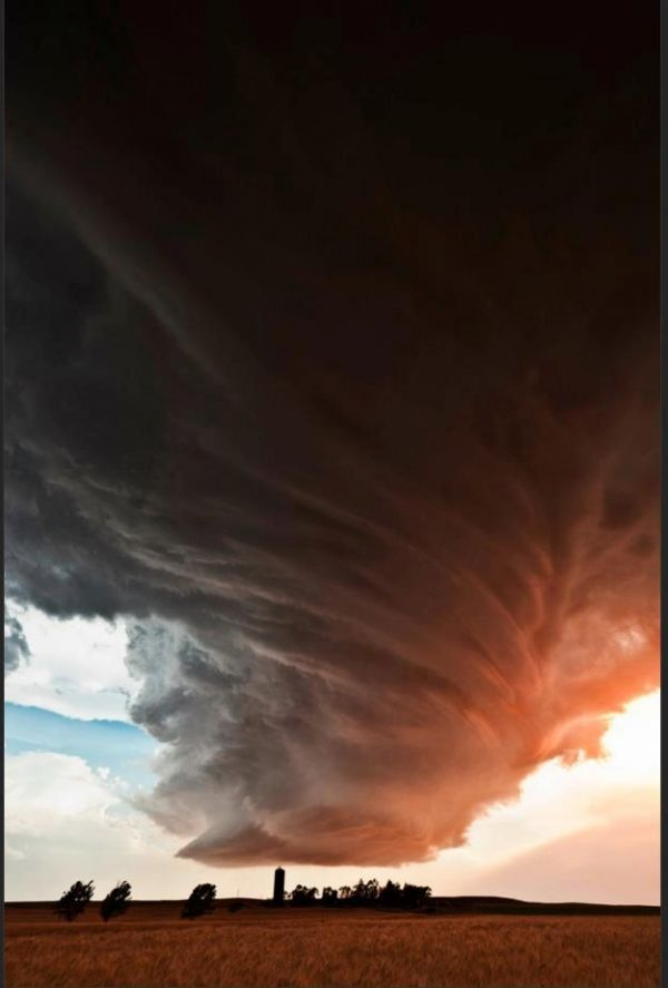 Supercell Thunderstorm clouds in Kansas by Camille Seaman
