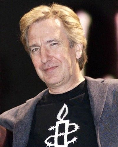 "Alan Rickman attends the Amnesty International ""We Know Where You Live"" Concert on June 4, 2001 in London. He performed ""The Four Yorkshiremen"" with Harry Enfield, Eddie Izzard and Vic Reeves. (not pictured) His T-shirt has the logo for ""Amnesty International"" on it."