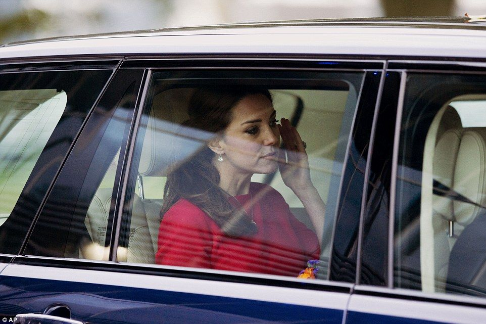 Wiping away tears: The Duchess was driven away looking visibly upset after meeting a mother who lost her child at three months old