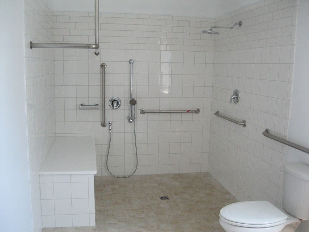 wheelchair showers | handicap-shower-complete-with-custom-built-grap ...