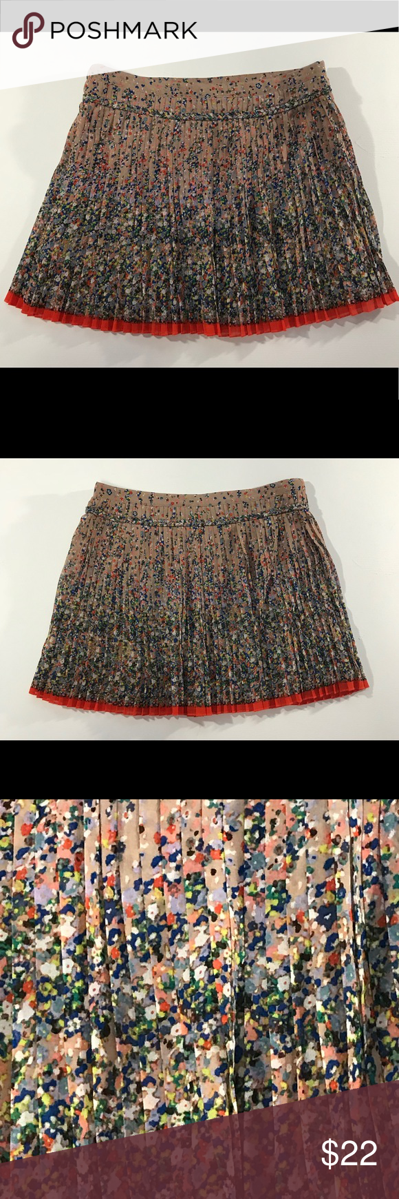 American Eagle Pleated Floral Mini Skirt sz 6 100% polyester skirt has a zipper on the left hip. Skirt is a pretty flower print & has pleats all around. Background is a mauve-pink. American Eagle Outfitters Skirts Mini