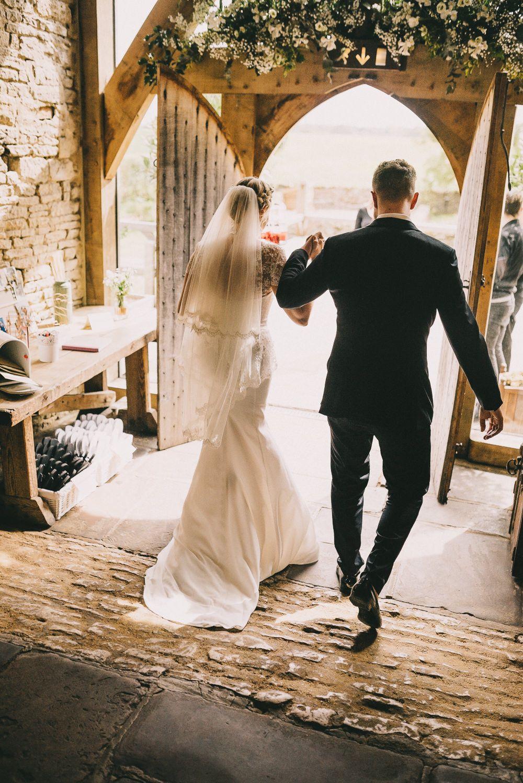 Modern vintage wedding dresses  Suzanne Neville Sun Rose Wedding Dress for a classic rustic wedding