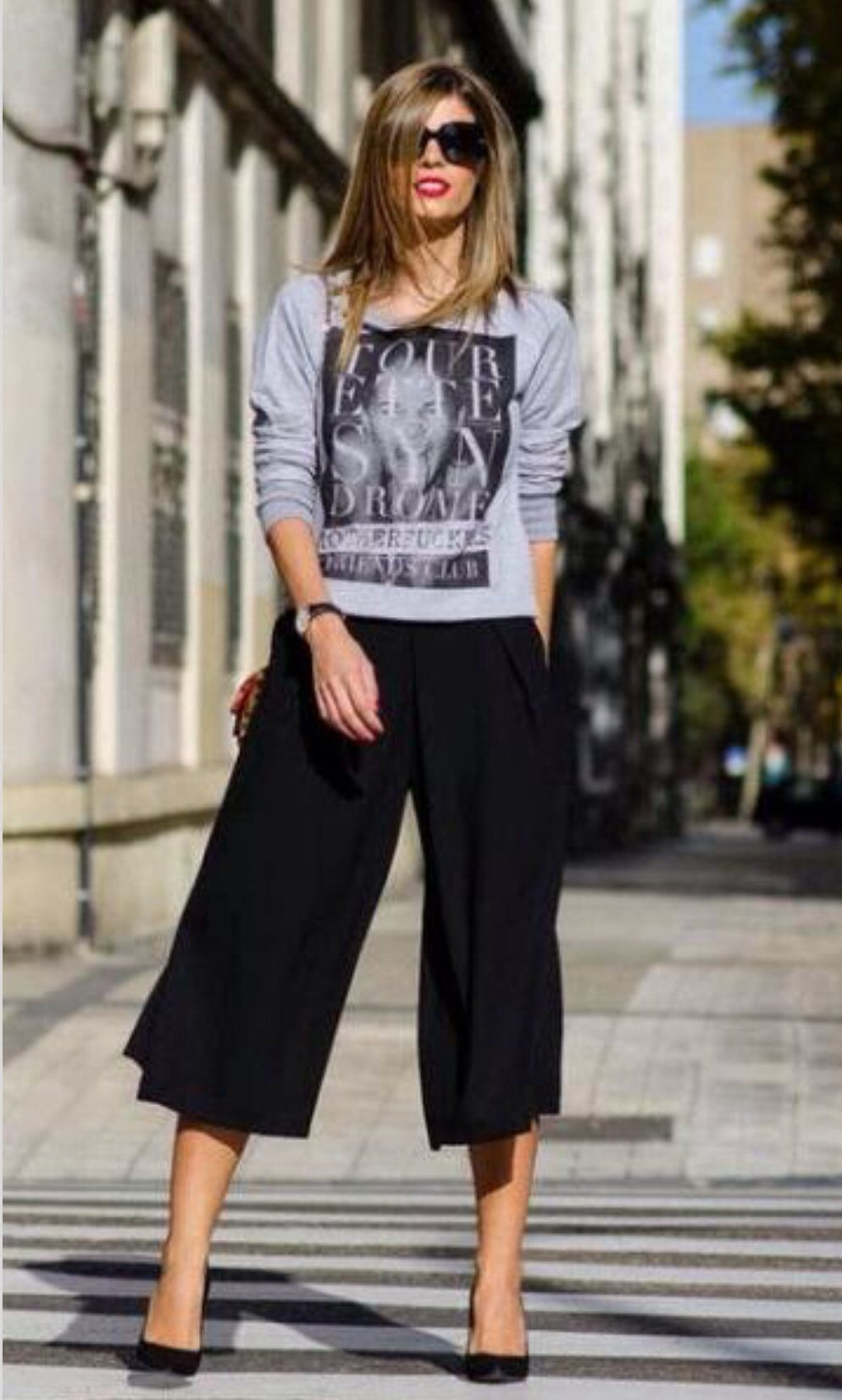 Black and gray graphic tee with black culottes.