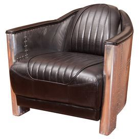 Bring Stately Style To Your Living Room Or Den With This Handsome Arm Chair Featuring Leather Upholstery And Nailhead Accents