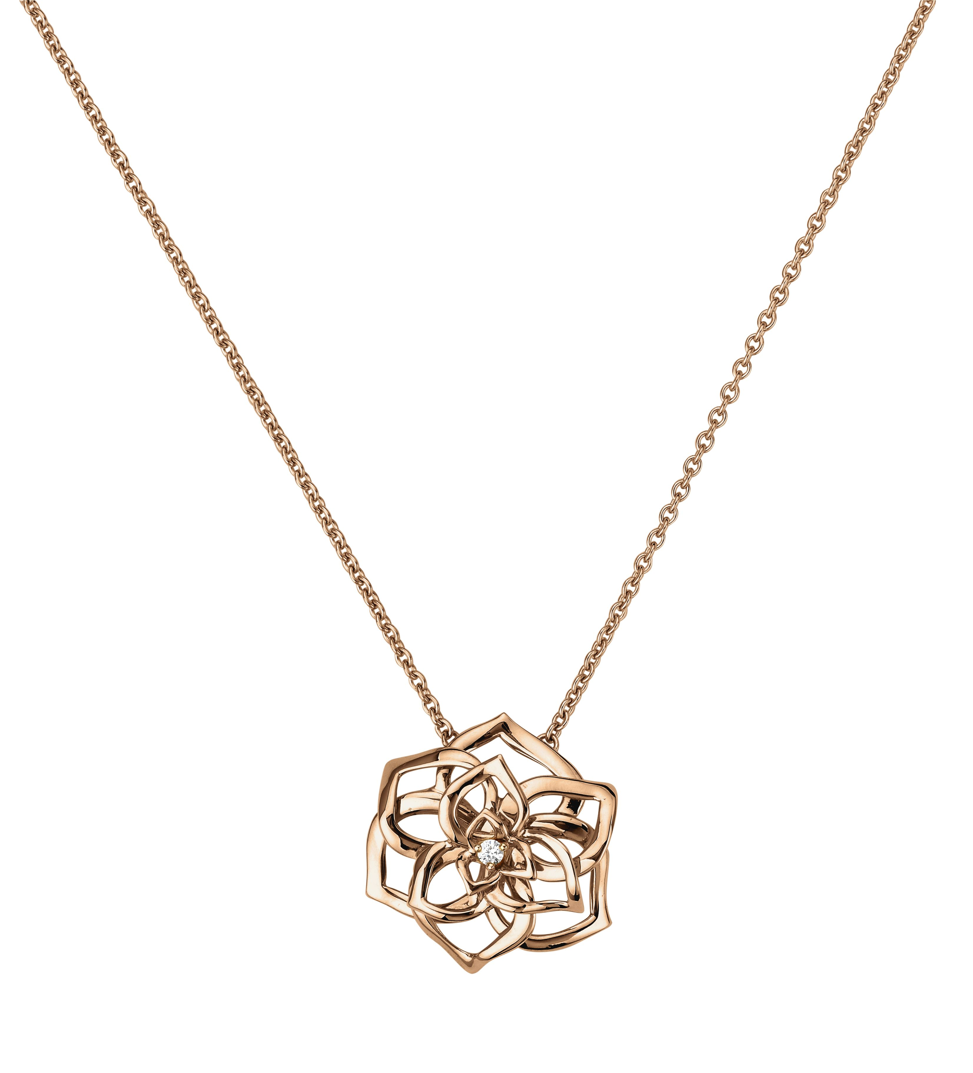 Piaget rose pendant in k rose gold set with one brilliantcut