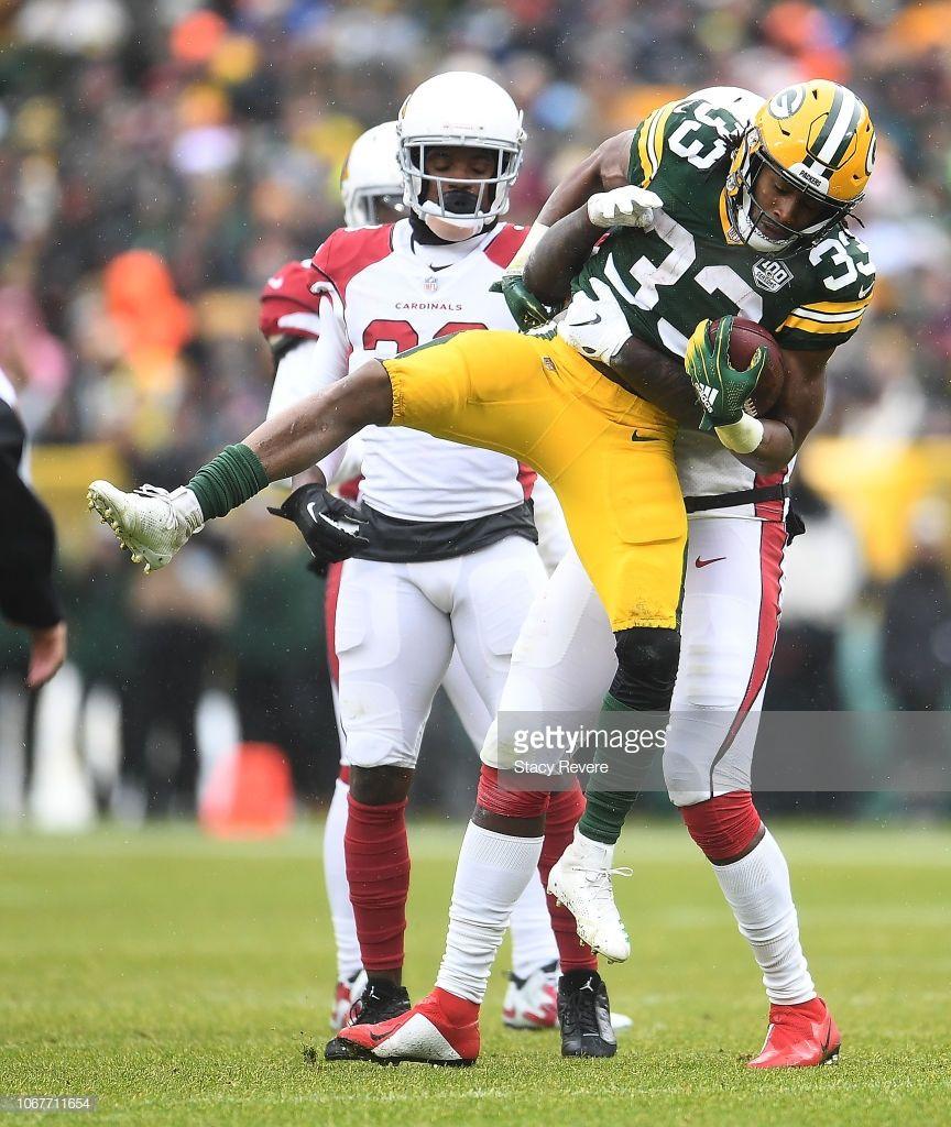 Aaron Jones Of The Green Bay Packers Is Tackled By Benson Mayowa Of Green Bay Packers Green Bay Packers