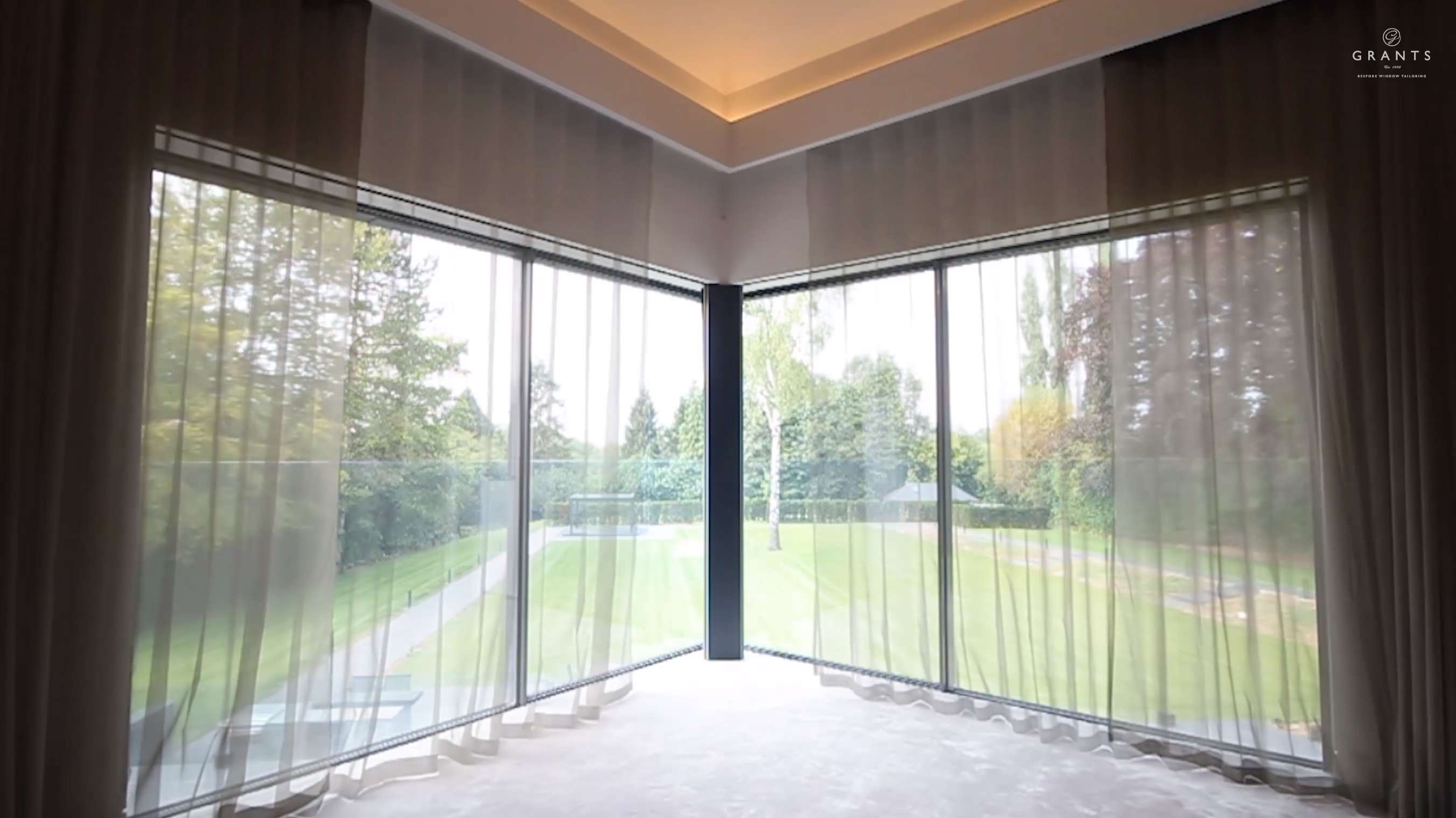 Luxurious Master's Bedroom with Blackout Blinds and Curtains in sliding doors and window. Blinds and side channels are concealed when not in use to create a completely contemporary look