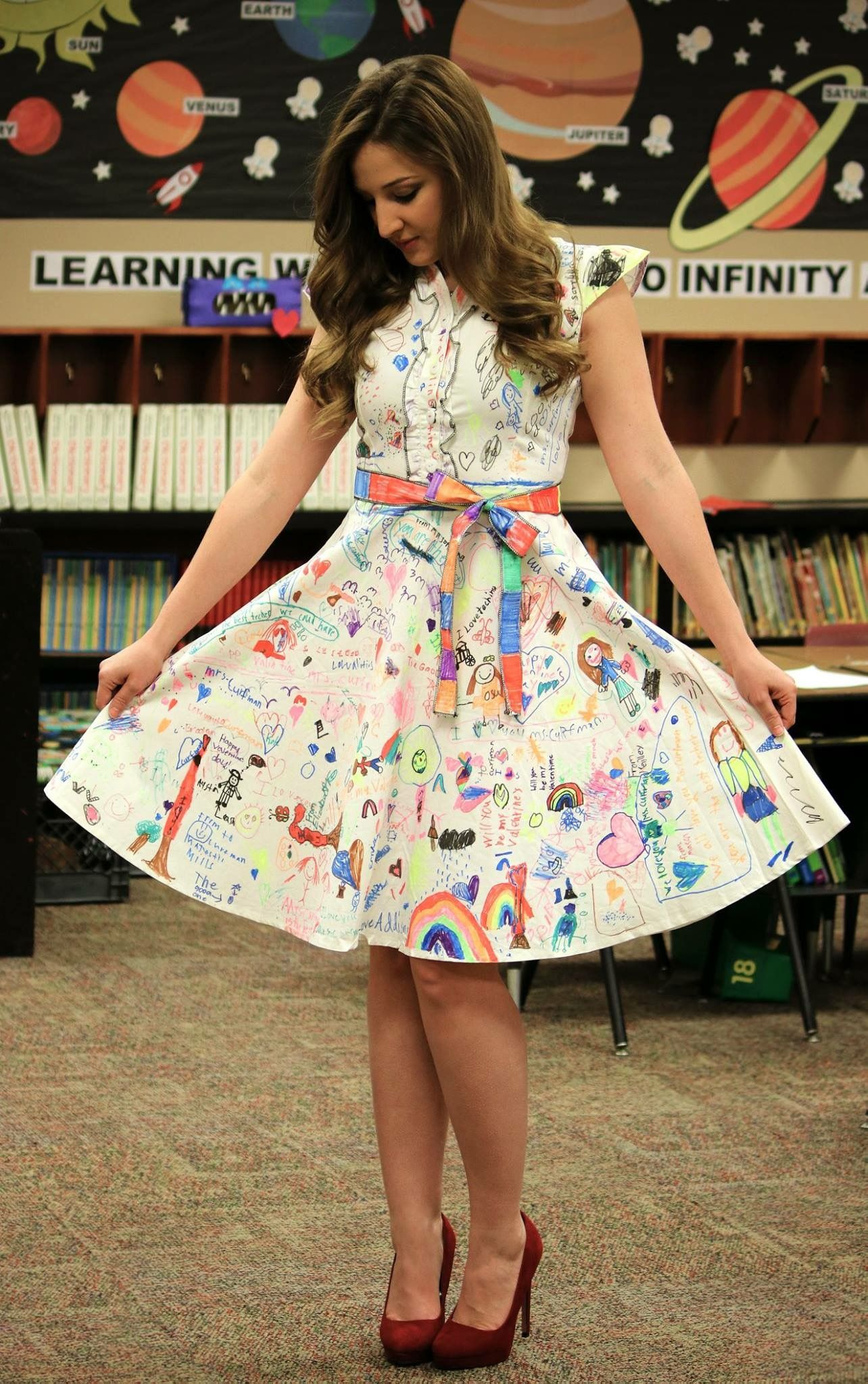 Bring in white dress for students to decorate on first day
