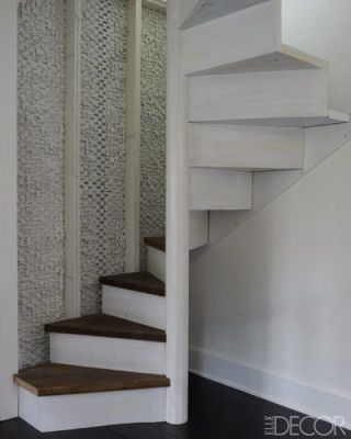 A staircase crafted of reclaimed wood leads to the  attic, which houses Morey's office and a guest bedroom .