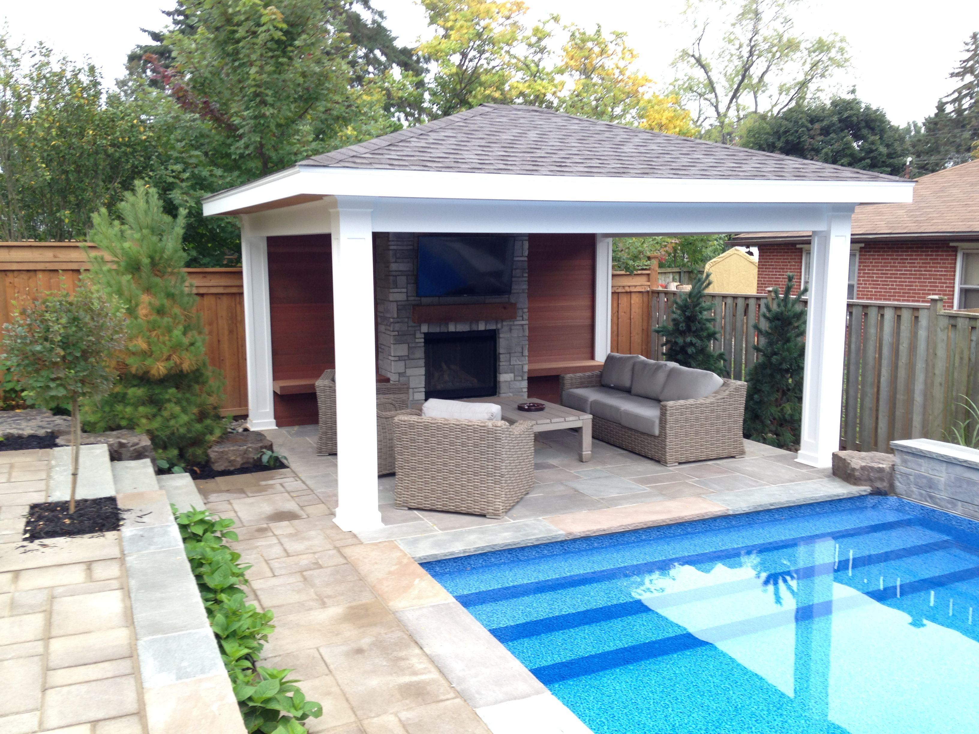 Poolside pavilion/ pool house featuring fireplace. Kayu