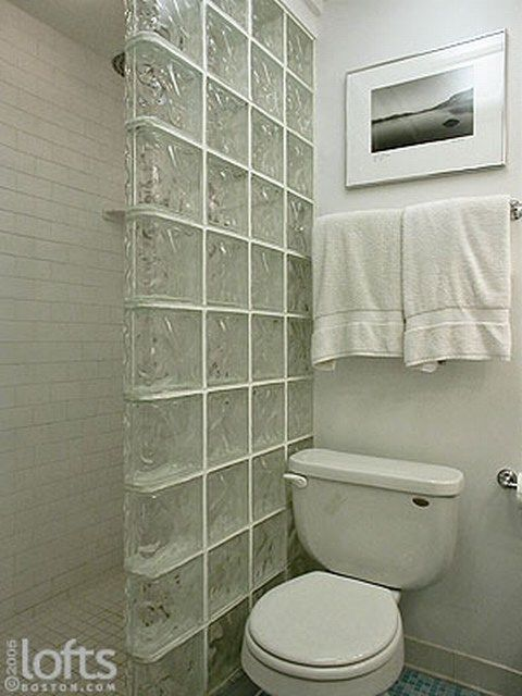 mini-shower with glass block wall, replace the toilet with a sink... and voila!