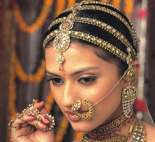 This Lovely Indian Lady Has An Ornate Veil A Maang Tikka On Her Forehead Wedding JewelryIndian