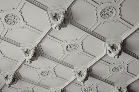 Detail of part of the plaster ceiling in the Dining Room at Gawthorpe Hall, Lancashire.