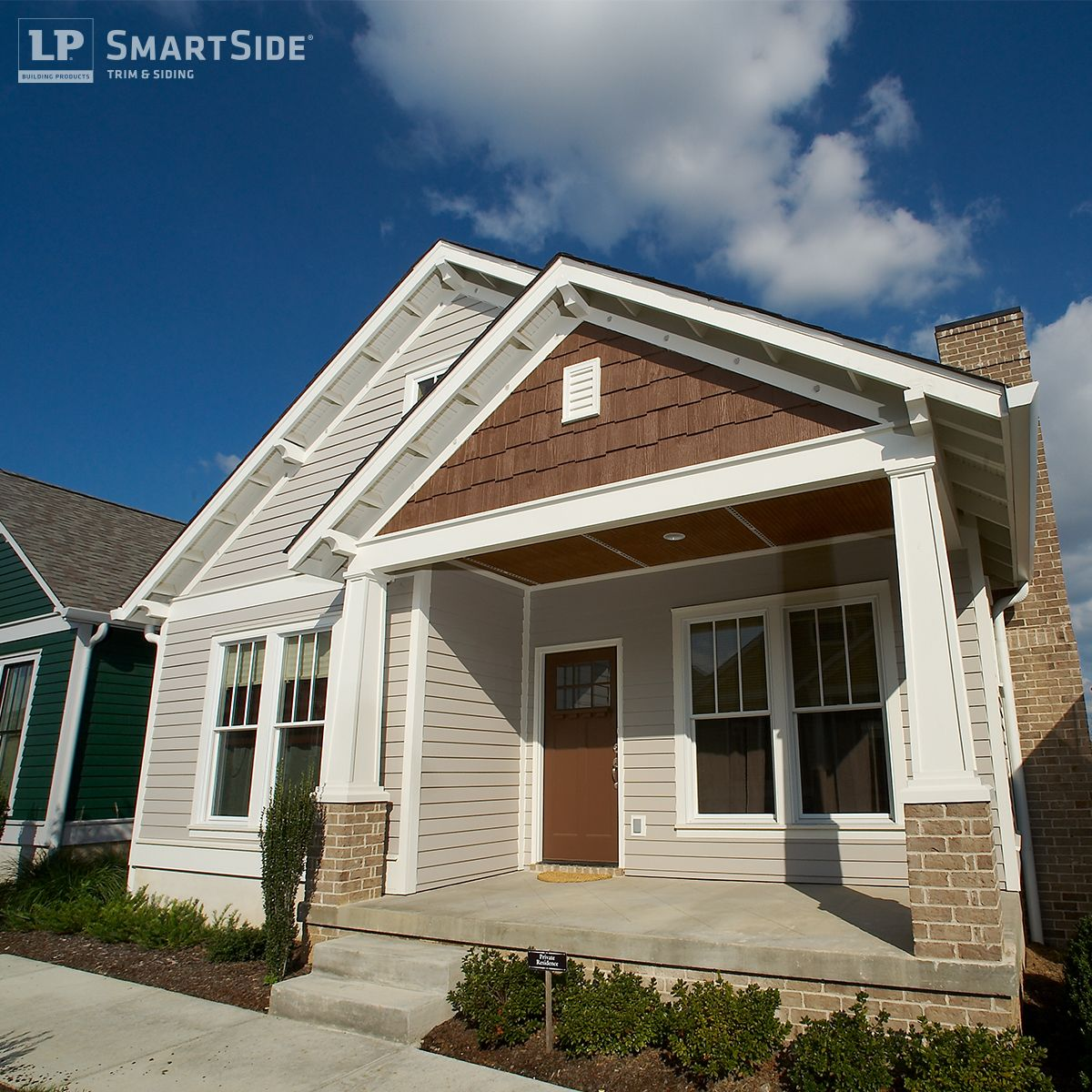 this home features lp smartside cedar shakes as a