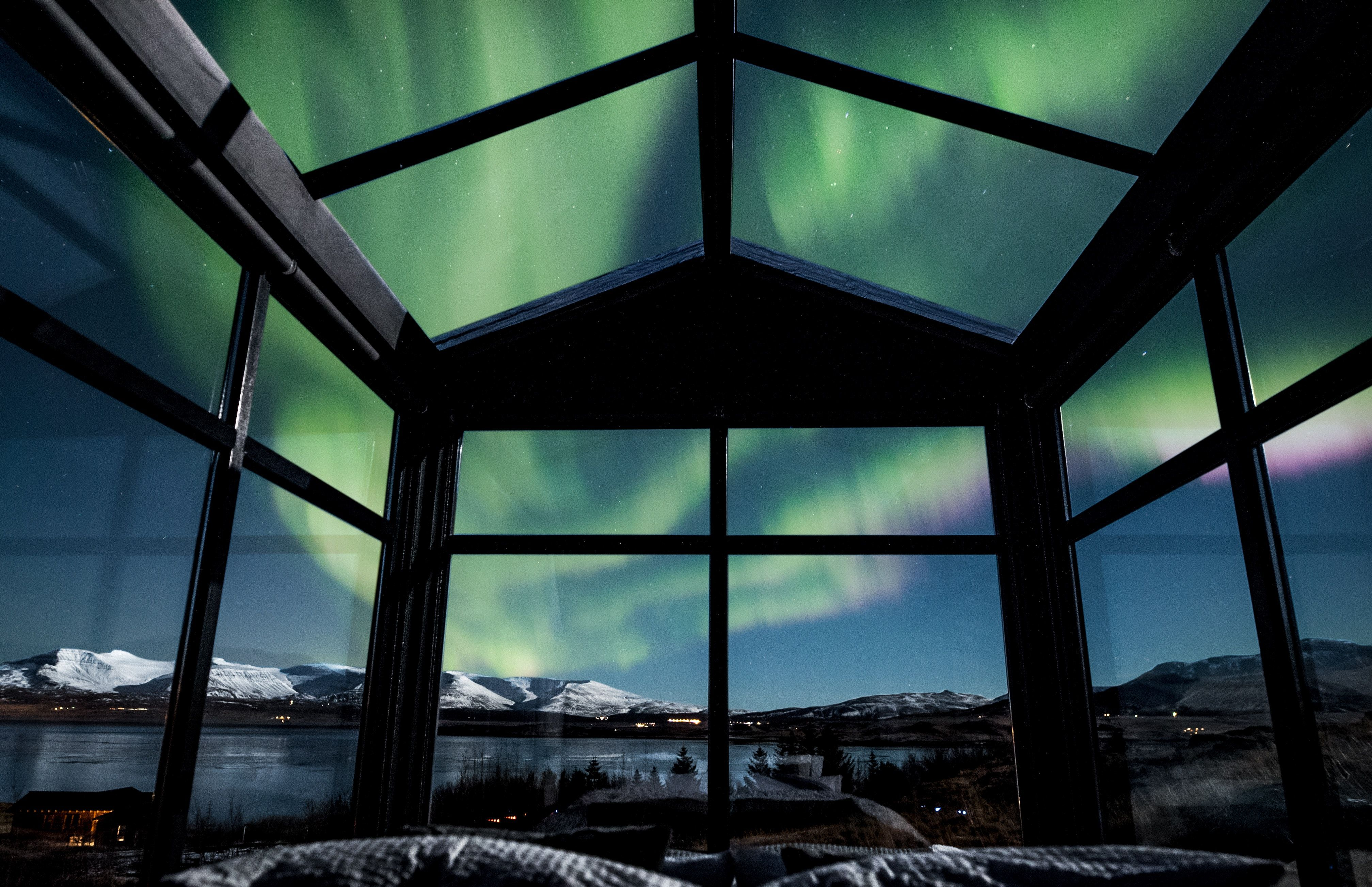 Catch Unobstructed Views Of The Aurora Borealis In This Icelandic Glass Hotel See The Northern Lights Northern Lights Iceland Northern Lights Viewing