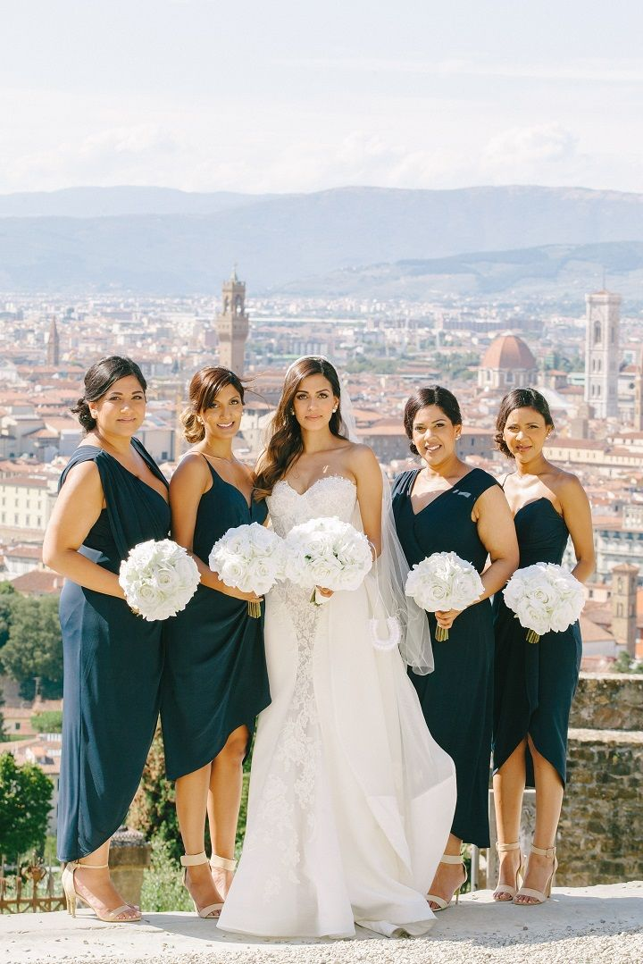 Navy blue mismatches bridesmaid dress and pure white wedding bouquets for a Breathtaking Fairytale Venice Wedding + Steven Khalil wedding dress | itakeyou.co.uk #wedding #venicewedding #destinationwedding #elegantwedding #white #goldwedding #fairytalewedding