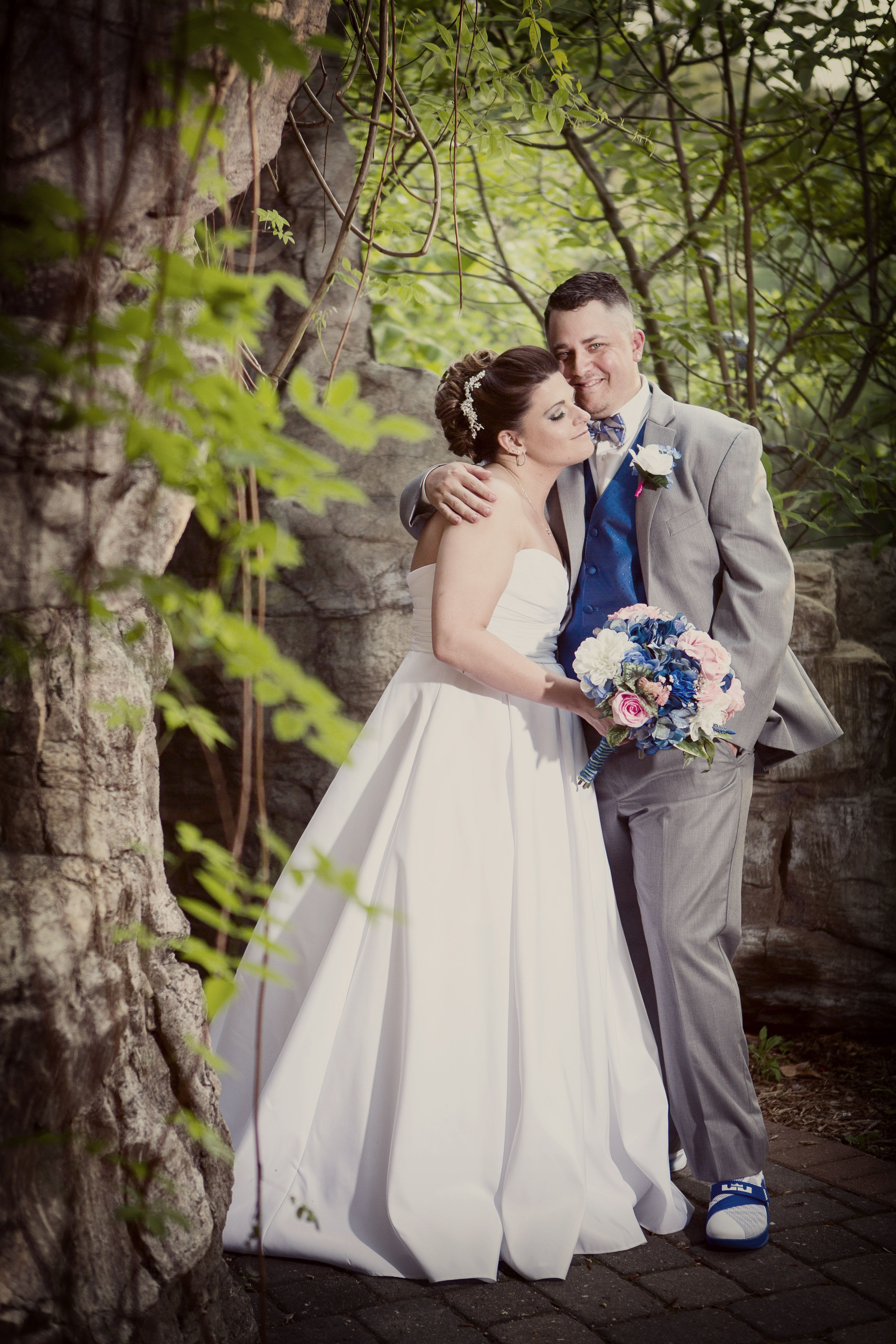 Bride And Groom Portrait At An Outdoor Summer Wedding At
