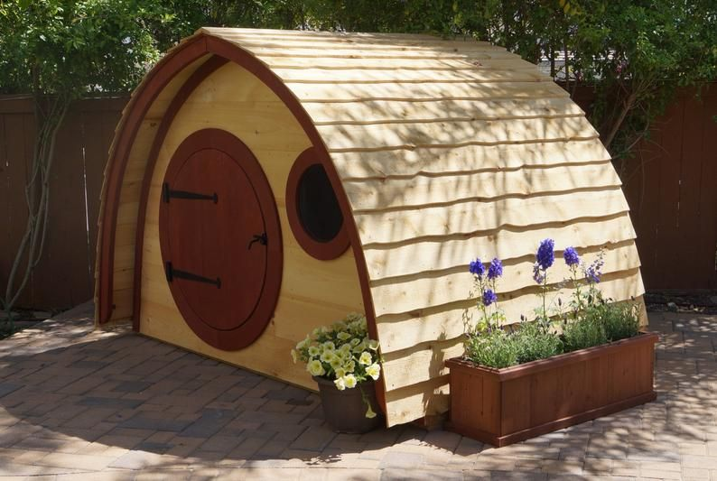 Photo of Hobbit Hole Playhouse Kit: outdoor wooden kids playhouse with round front door and round windows