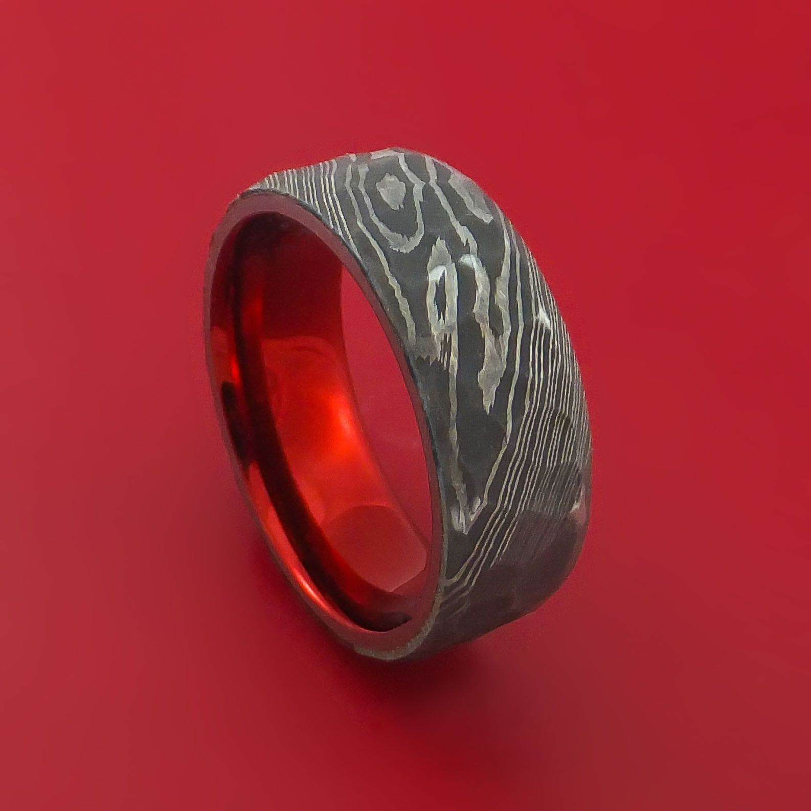 Damascus Steel Ring with Rock Hammer Finish and Anodized Titanium
