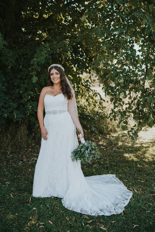 Stunning bridal portrait of smiling boho bride relaxed alternative