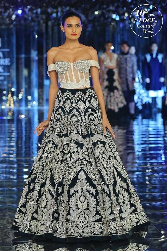 57a44736cc77c8 Love this off shoulder white lehenga blouse with dark black skirt by Manish  Malhotra #Frugal2Fab