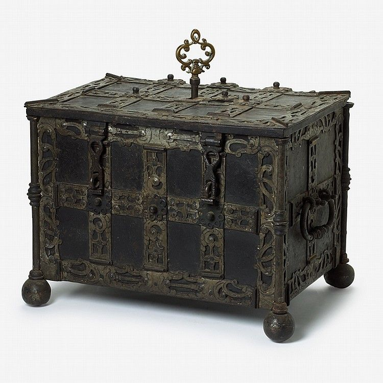 German steel strongbox 18th/19th century. The rectangular hinged lid with elaborate strapwork locking mechanism to underside, opening to a vacant interior, the case with engraved onlaid straps and twin handles to sides, raised on ball feet.