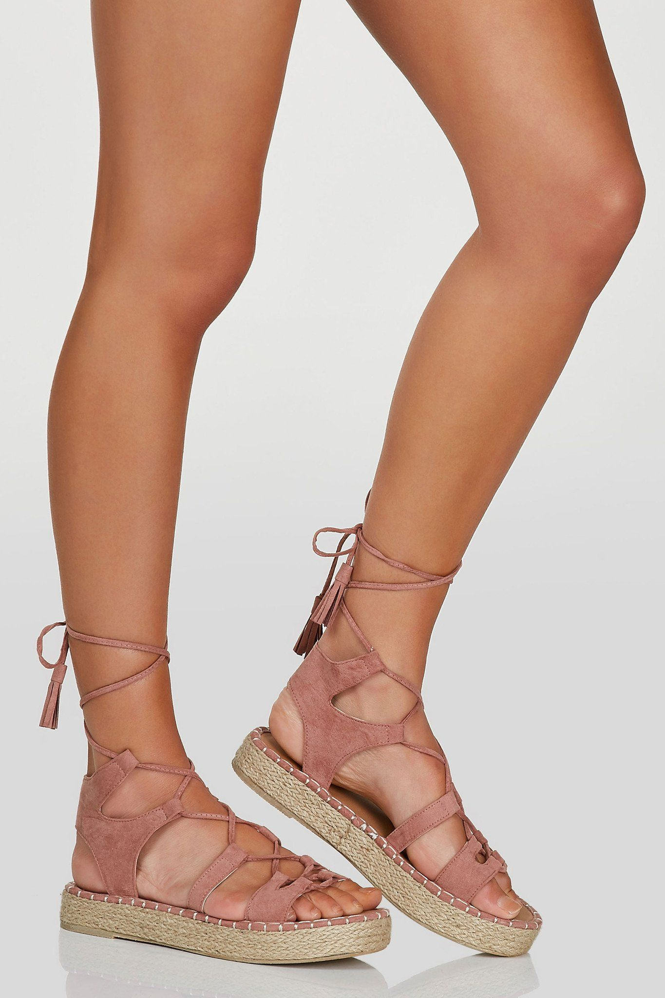 An Adorable Pair Of Espadrille Sandals With Gladiator Lace Up