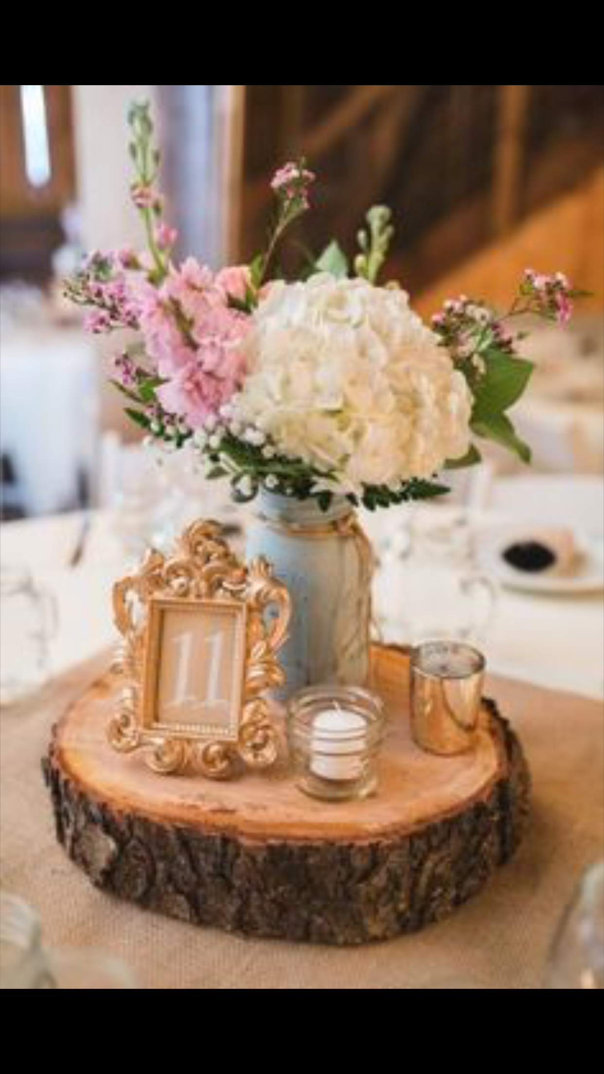 Wedding Reception Center Piece On A Wood Slab With Gold