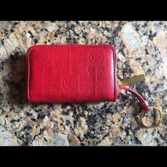 Tory Burch Coin Wallet Authentic Tory Burch Coin Wallet, has some wear to the leather but is in good condition besides that! Great to put change or credit cards in! Not to mention I love the color! Tory Burch Bags Wallets