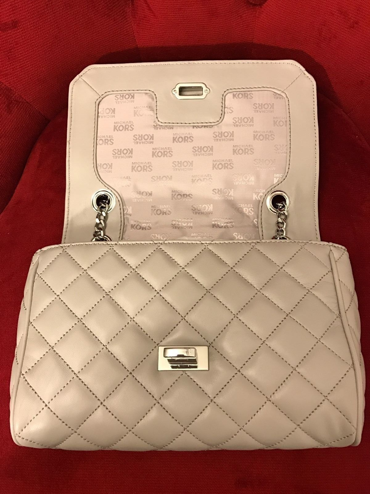Michael Kors Vivianne Pearl Grey Shoulder Flap Quilted Leather Handbag      Read more reviews of the product by visiting the link on the image. 6a8fb83ab2cfc