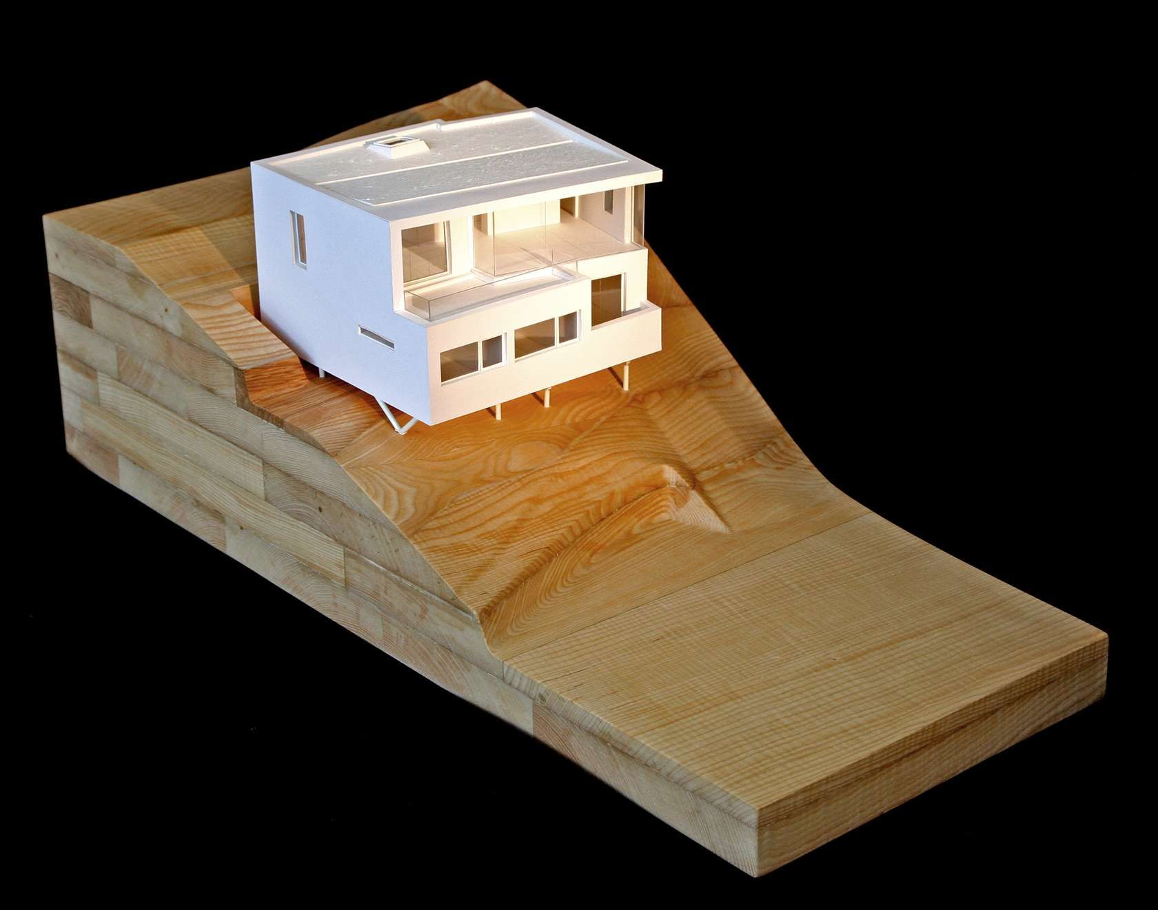 New build house on a sloping site overlooking the sea on the South ...