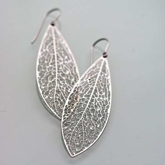 Reticulate - stainless steel leaf earrings, organic, intricate, science, nature. From Nervous System. $40 Reticulate, meaning net-like, describes the complex branching patterns that govern the veins in leaves of most flowering plants.