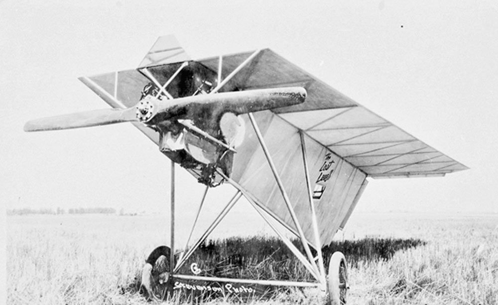 Closeup view of propeller, cab and wing of experimental aircraft sitting in a field. c.1931 Oregon