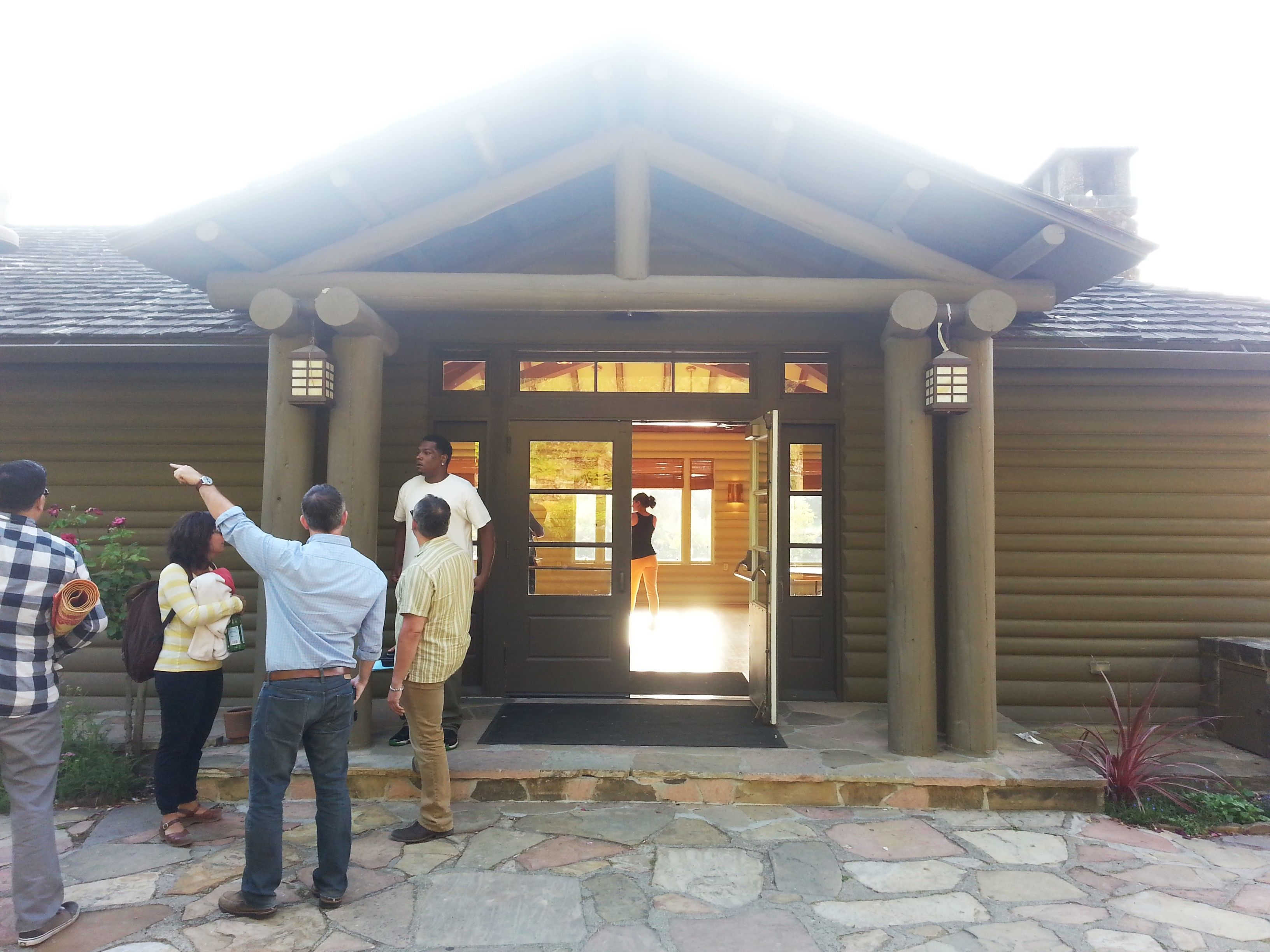 View of the entrance, where guests would enter.  Cobblestone patio outside.