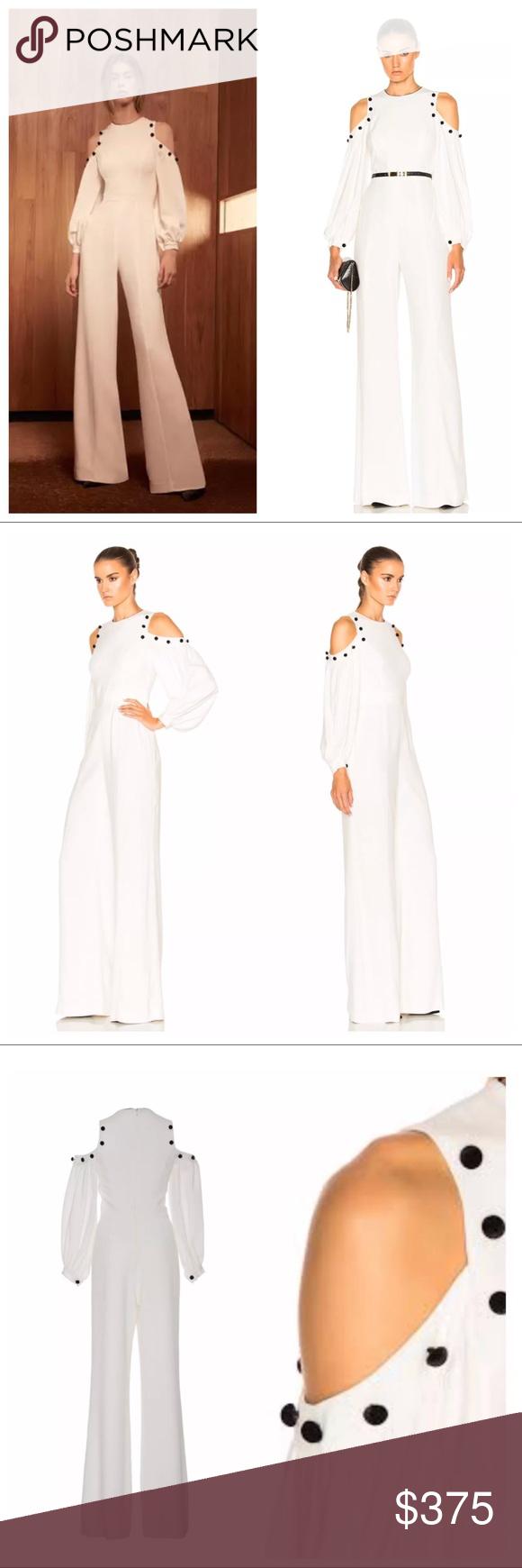 614752c3725 Alexis Easton White Jumpsuit Editor s Note This Alexis Easton Cold Shoulder  Jumpsuit features a jewel neckline