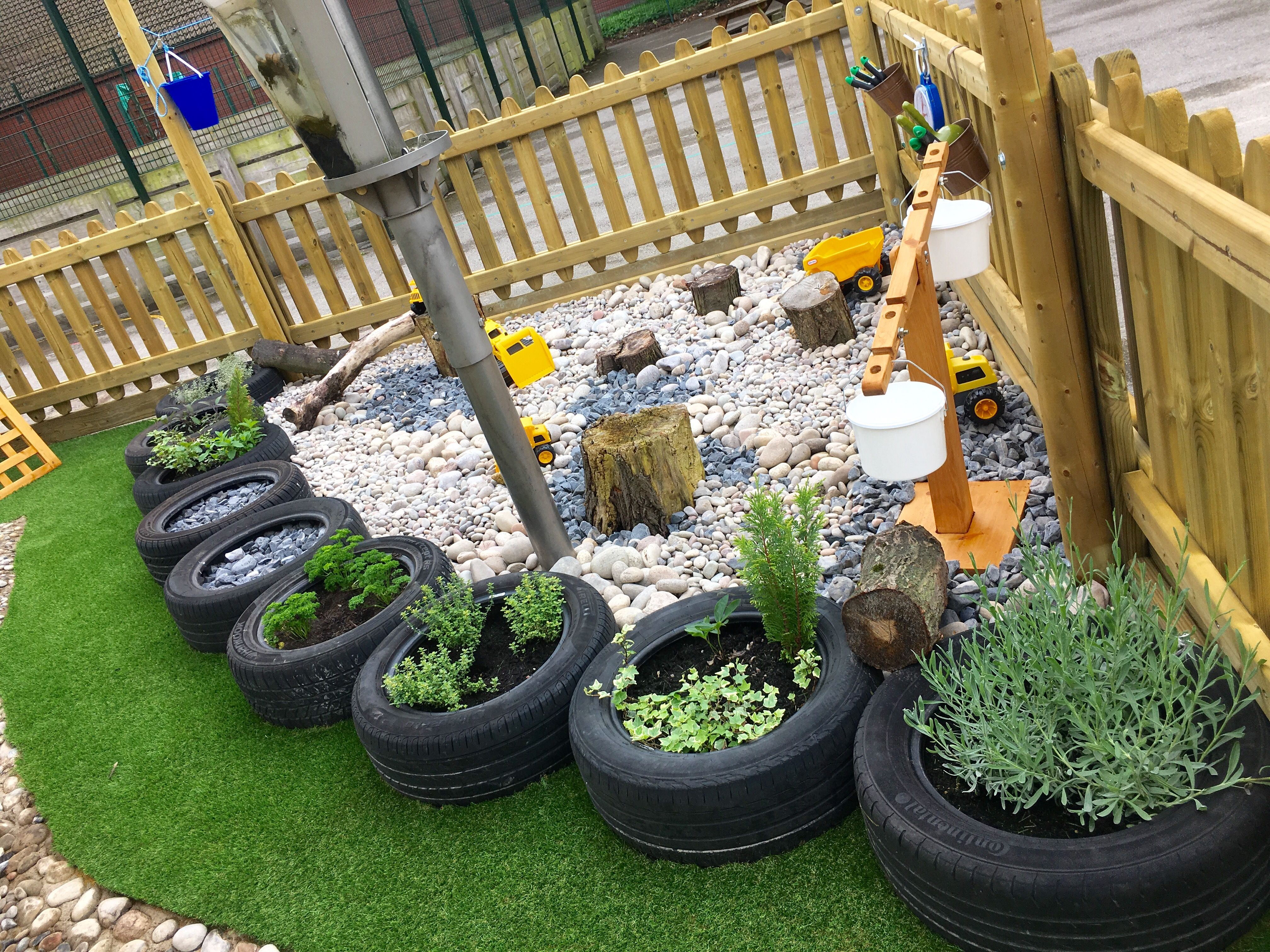 outdoor learning eyfs tyre planting pebble digging pit sensory