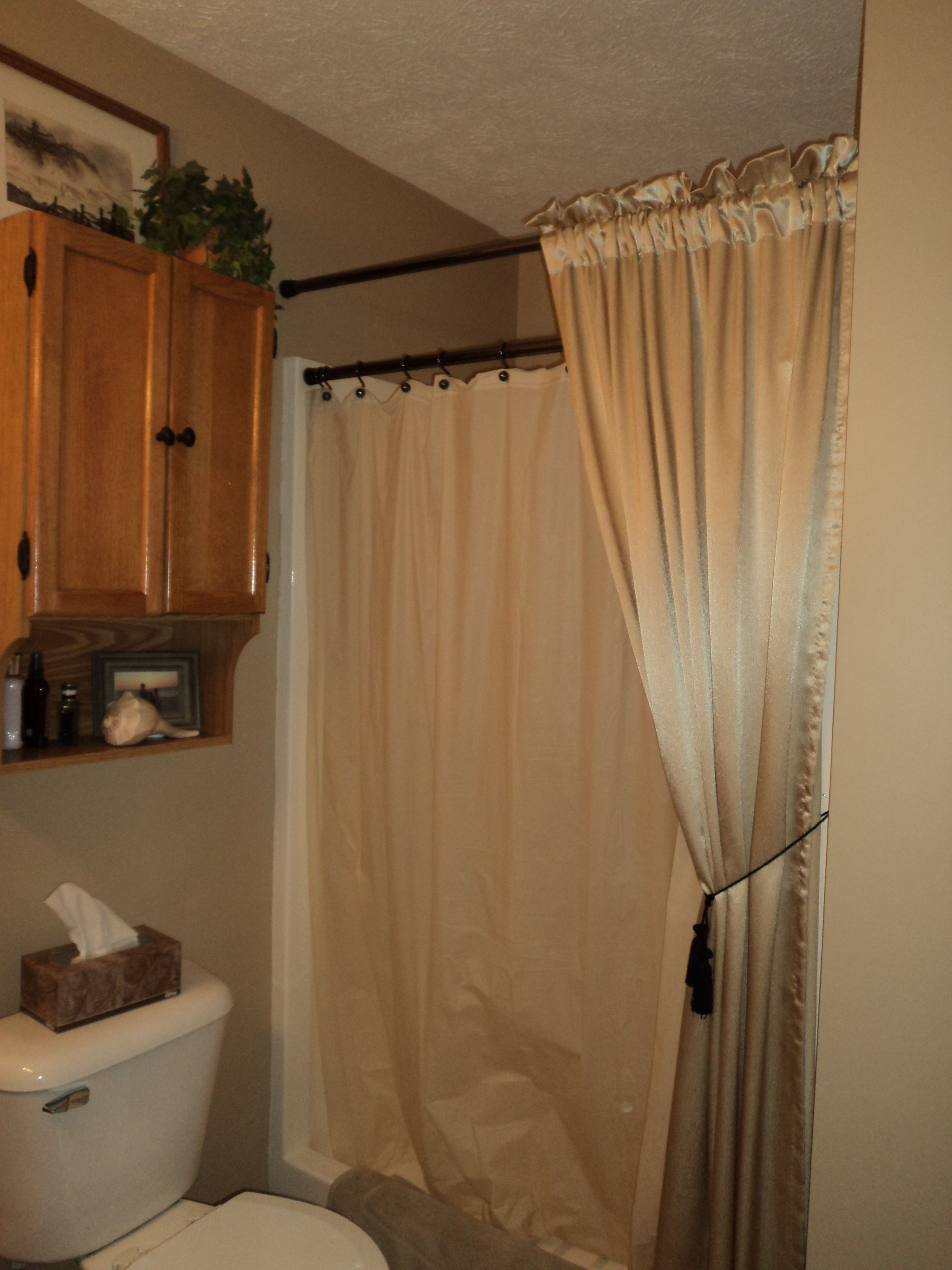 Outside window treatment ideas  in the master bath i used  shower rods u the outside one is the