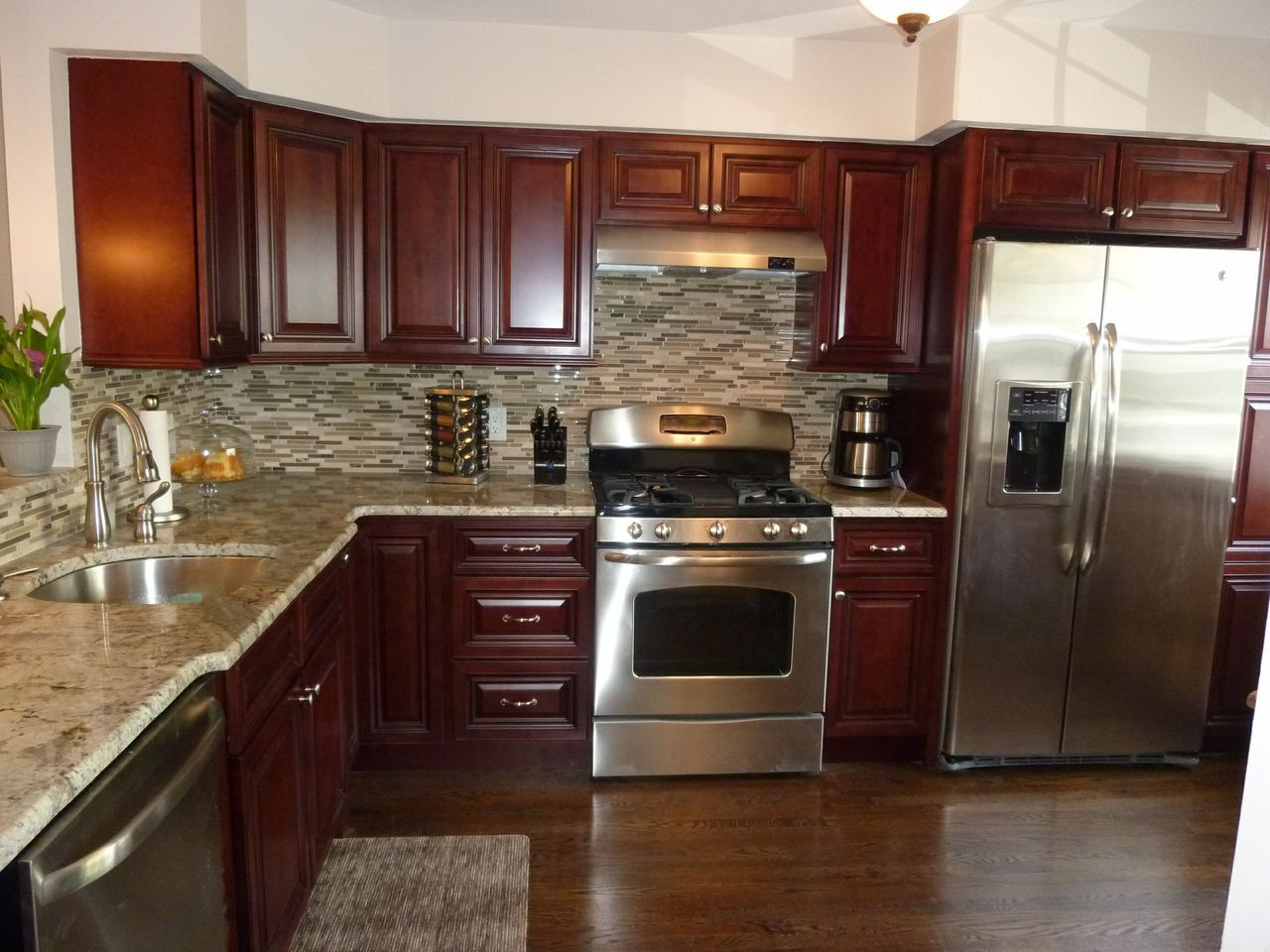 Modern Kitchen Stainless Steel Appliances Granite Counter Tops Tile Back Splash Mahogany