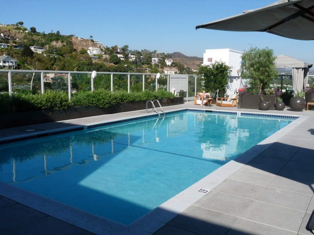 Awesome Outdoor Swimming Pool Design Ideas With Glass Paneling Fence