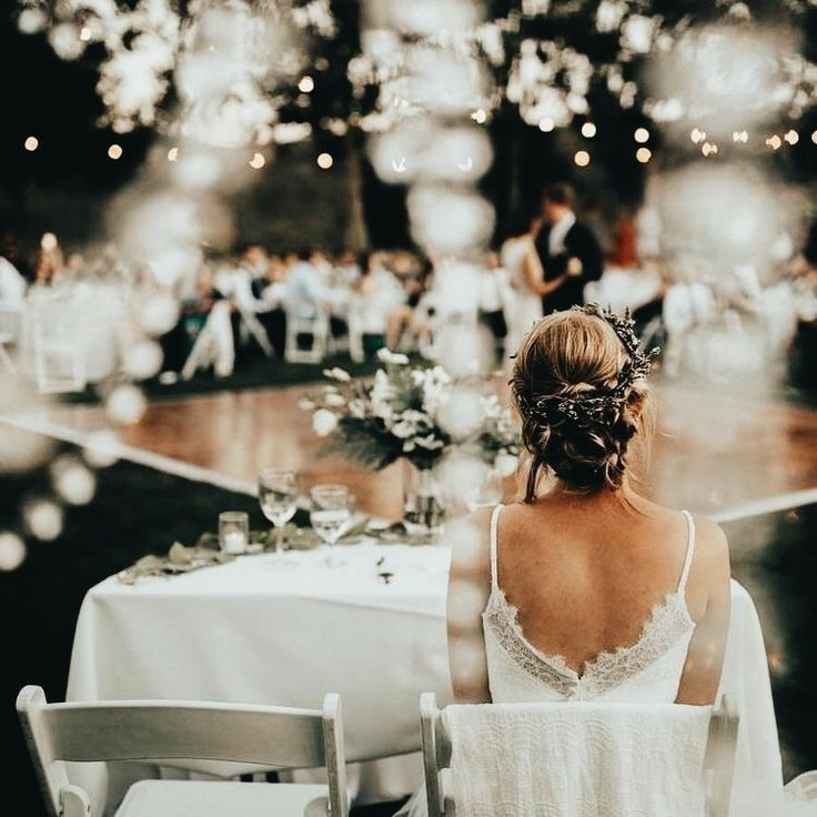 Ideas For Wedding Reception Without Dancing: Bride Sitting At Table During Wedding Reception. Outdoor