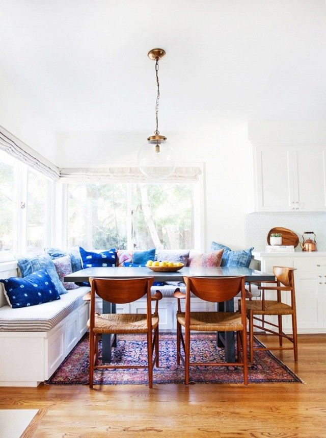 Boho Chic Inspired Dinning Nook With A Moroccan Rug, And A Glass Pendant  Light