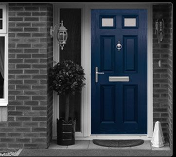 blue front door with dark gray brick and white trim. AND its TARDIS ...