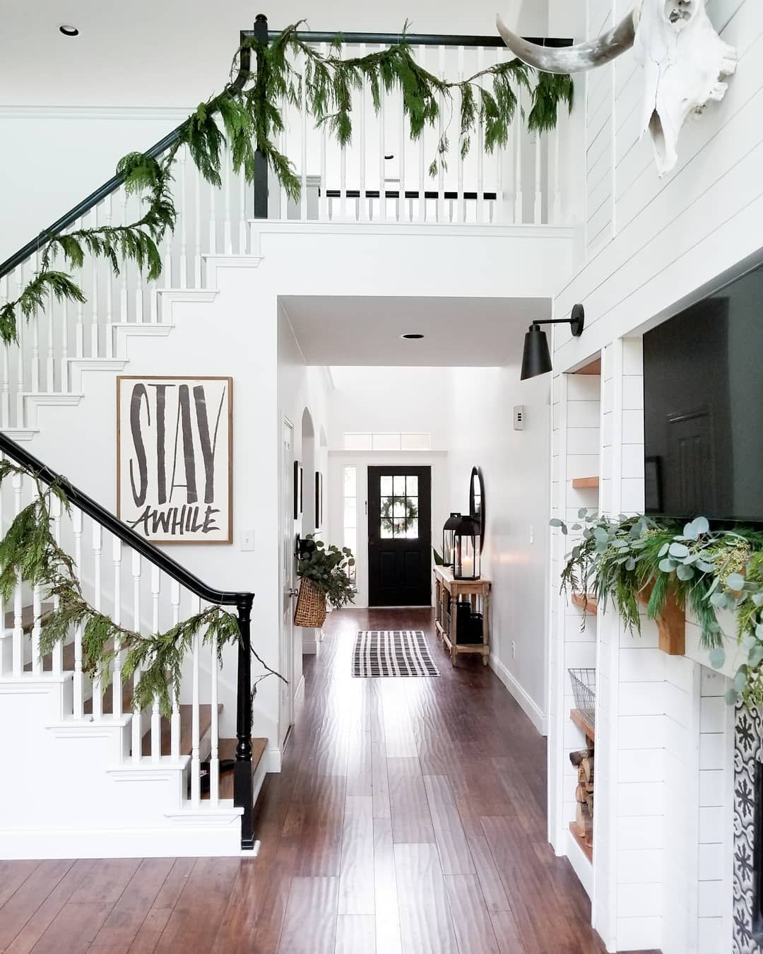 100 Awesome Christmas Stairs Decoration Ideas: Farmhouse Christmas Entry With Simple Greenery #shiplap